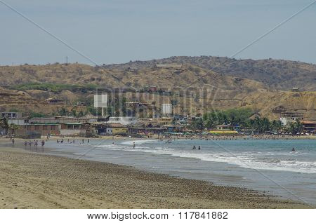 People Swiming In Pacific Ocean In Mancora Surfer's Beach In Peru.