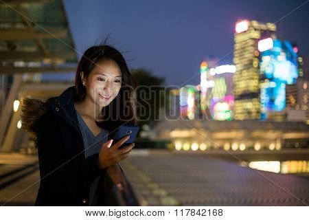 Woman use phone at outdoor