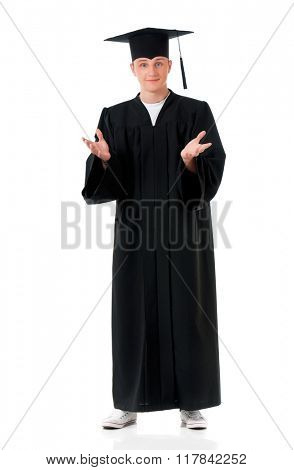 Handsome graduate guy student in mantle, isolated on white background