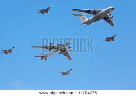 Il-76 And Tu-95Ms Planes Accompanied By Group Of Fighters Mig-29 On Parade