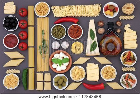 Healthy mediterranean diet and food ingredients forming an abstract background over grey.