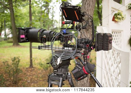RUSSIA, MOSCOW - 30 JUL, 2015: Professional digital video camera with a wire on a tripod in the Sokolniki park.
