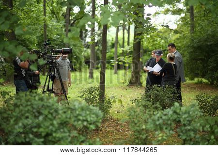 RUSSIA, MOSCOW - 30 JUL, 2015: Actors and assistents are standing in the Sokolniki park and shooting movie (Maximum shock).