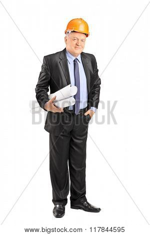 Full length portrait of a mature architect with an orange helmet holding construction plans isolated on white background