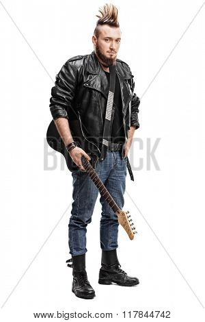 Full length portrait of a punk rock guitarist holding an electric guitar isolated on white background