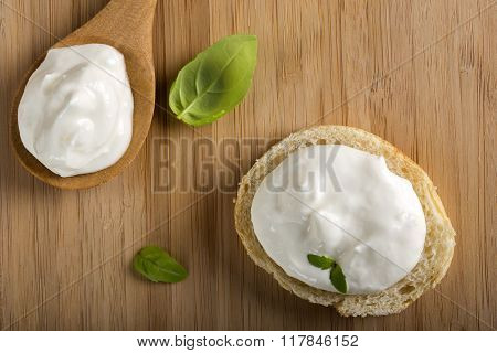 Bread And Spoon With Cheese Cream