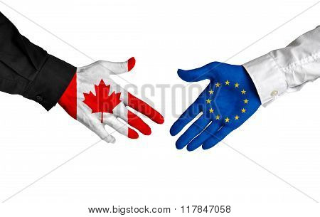 Canada and European Union leaders shaking hands on a deal agreement
