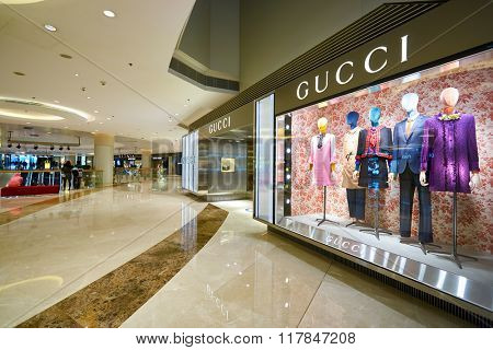 HONG KONG - JANUARY 27, 2016: shopwindow of Gucci store at Elements Shopping Mall. Gucci is a luxury Italian fashion and leather goods brand, part of the Gucci Group