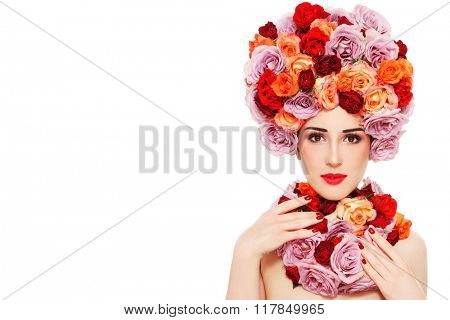 Young beautiful woman in fancy wig of colorful roses over white background, copy space
