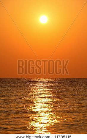 Sun Sets Over Horizon, Sea, Orange Sun's Reflection In Sea Water