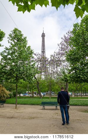 Paris, France - May 15, 2015: People At The Champs De Mars, At The Foot Of The Eiffel Tower In Paris