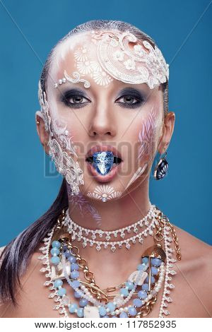 Woman In Beauty Photo Posing With Jewelry In Mouth
