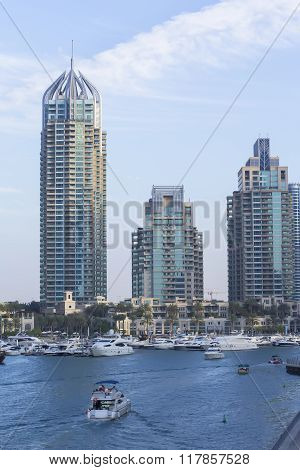 background boat landscape and skyscrapers in Dubai Marina in the evening