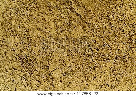 closeup of a rustic brown plastered wall