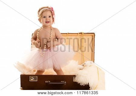 attractive female baby in the suitcase