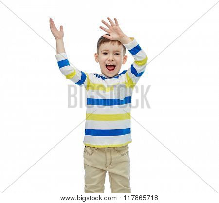 childhood, fashion, joy and people concept - happy little boy waving hands