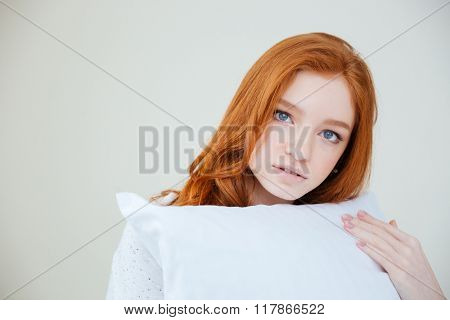Beautiful redhead woman looking at camera isolated on a white background