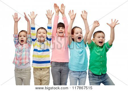 childhood, fashion, gesture and people concept - happy smiling friends raising fists and celebrating victory
