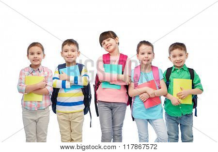 childhood, preschool education, learning and people concept - group of happy smiling little children with school bags and notebooks