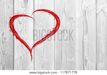 Concept or conceptual painted red abstract heart shape love symbol made by happy child at school, old vintage wood background