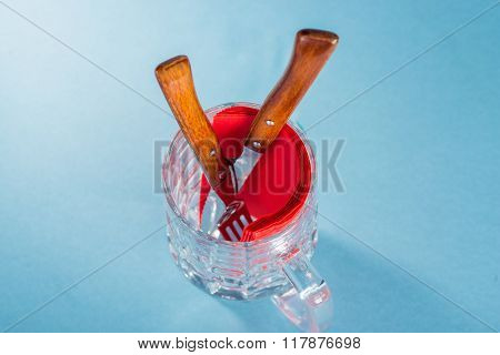 Cutlery and napkins in beer glass