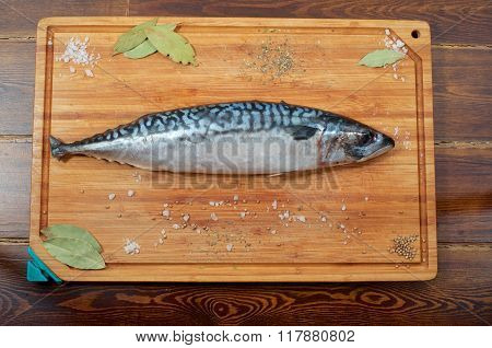 A Mackerel On Wooden Plate With Spices From Top