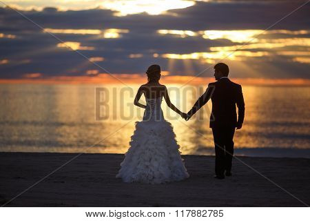 Wedding Couple In Sunset
