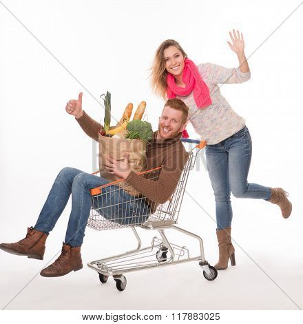 Happy couple with shopping cart