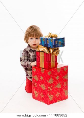 Little baby hiding behind presents