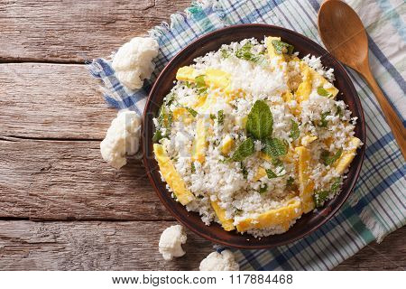 Cauliflower Rice With Scrambled Eggs And Herbs. Horizontal Top View