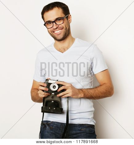 young man with a retro camera