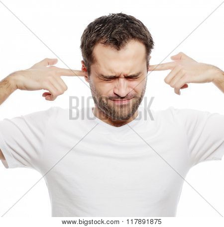 man hold hands on temples ears