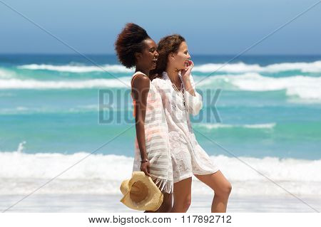Two Female Friends Laughing At The Beach