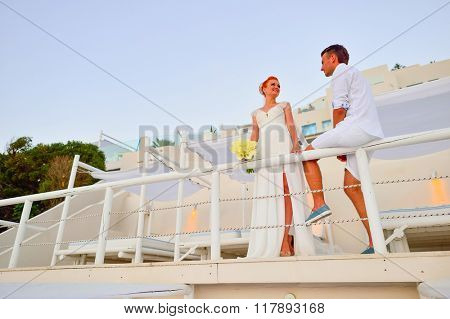 Beautiful young couple bride and groom posing on Santorini island, Greece