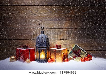 Christmas Gifts With Lantern In Snowfall