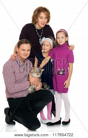 family with a Siberian cat