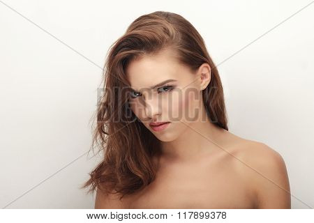 Closeup portrait of young tricky brunette woman with adorable makeup looking into camera posing on w