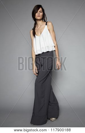 Woman posing shirt and wide-leg pants