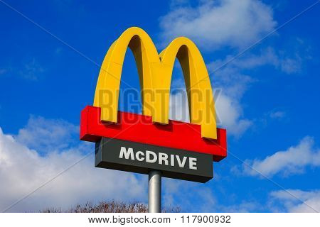 Classic McDonald's sign with blue sky