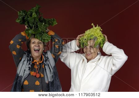 Two Senior Women Playing With a Chard And a Endive