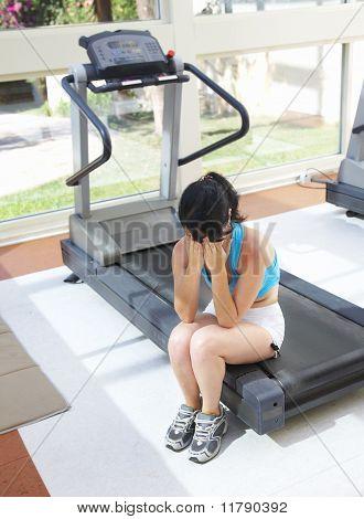 Girl Cries At A Sports Training Apparatus