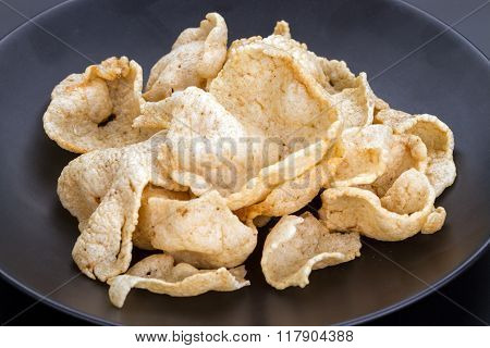Fish Crisp Rice Cracker On Black Plate