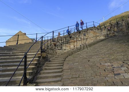 Whitby North Yorkshire UK 11th September 2015 people walking down the 199 steps whitby.