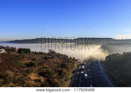 Fog on M62 motorway in autumn near Halifax.