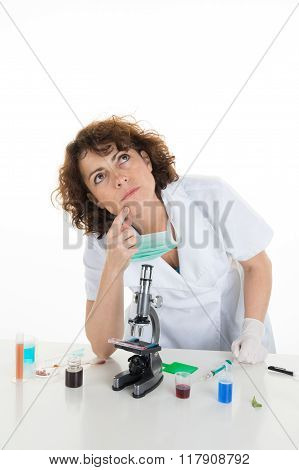 Pensive Brunette Female Clinician Thinking So Deep While Looking Up At  Office.
