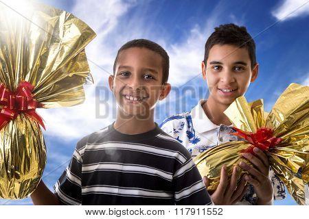 Happy Brazilian boys showing Easter Egg