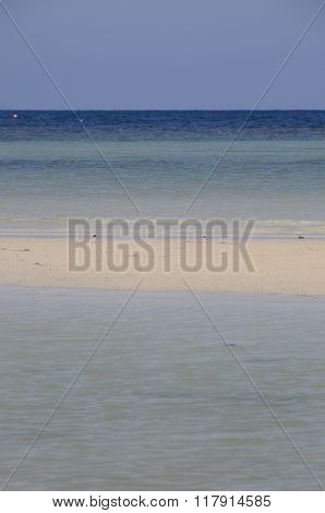Sand Beach And Clear Water
