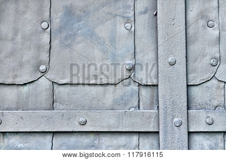 Industrial Textured Background - Grunge Surface Of Old Metal Light Grey Door With Rivets