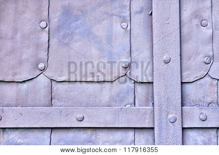 Rough Surface Of Old Metal Light Lilac Door With Rivets - Industrial Textured Background