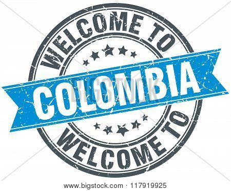 welcome to Colombia blue round vintage stamp